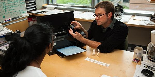 UW Bioengineering research assistant professor Barry Lutz with student.