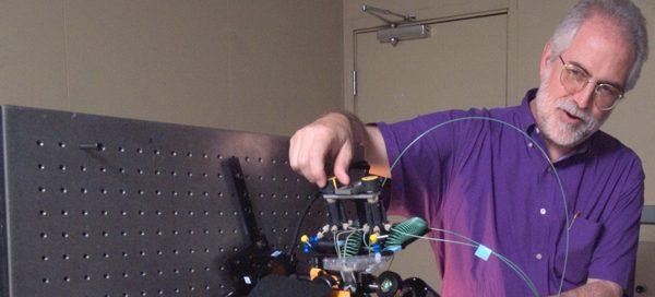 UW Bioengineering faculty Paul Yager demonstrates device in laboratory