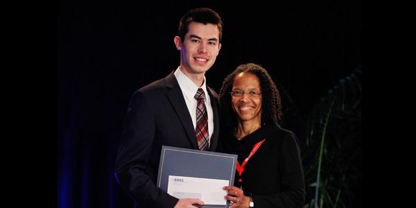 UW Bioengineering student Cameron Nemeth receiving BMES Undergraduate Design and Research Award
