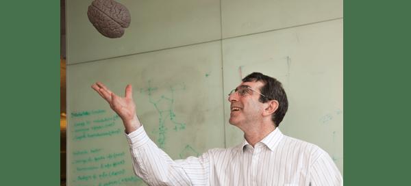 Research Associate Professor Eric Chudler juggles a rubber brain