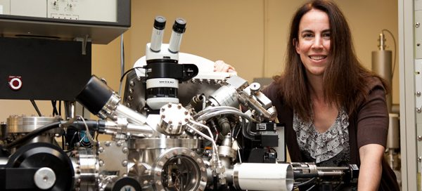 Lara Gamble, research associate professor of bioengineering, with lab equipment