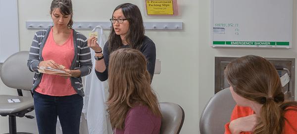 UW Bioengineering Assistant Professor Dr. Kim Woodrow leads activity about HIV virus action/mechanism
