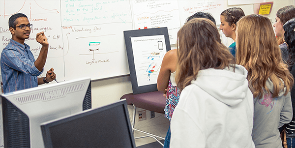 UW Bioengineering summer camp participants receive lesson about disease diagnostics from a graduate student
