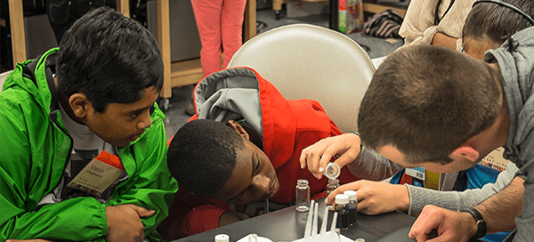 Students in youth outreach program participating in laboratory exploration and learning exercise