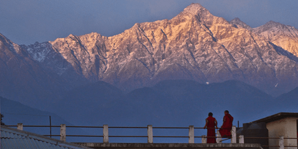 Monks in front of mountains