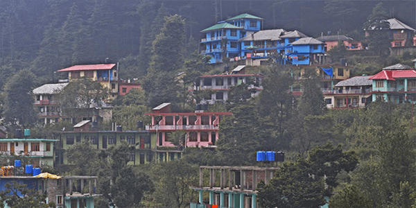 Houses on mountainside in India