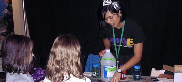 UW Bioengineering student working with young children
