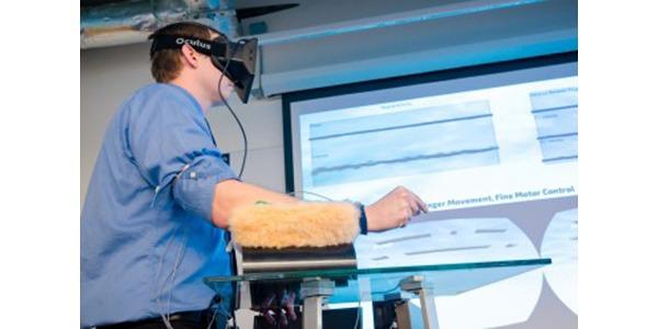 student demonstrates vHAB platform for stroke rehabilitation