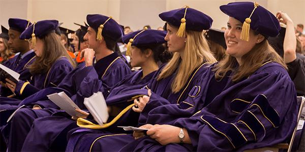 Bioengineering PhD graduates wearing graduation regalia