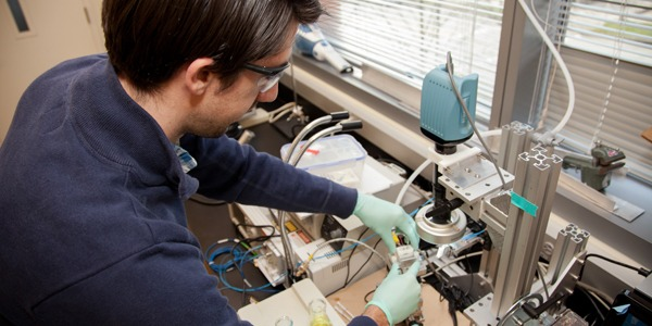 Student working with bioengineering laboratory equipment and devices