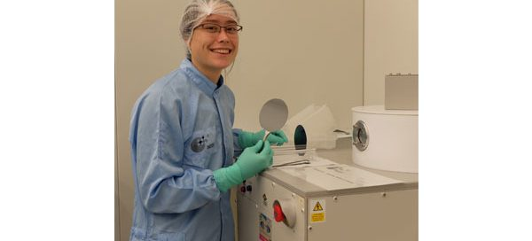 Sharon Newman in a cleanroom with silicon wafers holding the first few layers of her electrodes. They are about to be deposited with a few nanometer thick layer of SiC via the PECVD (Plasma-enhanced chemical vapor deposition) machine shown.