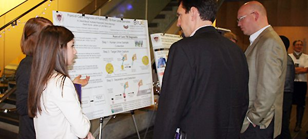 UW Bioengineering students discussing research poster at BioEngage symposium