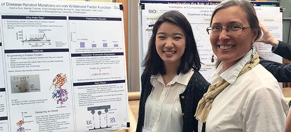 Wendy Thomas with student next to research poster