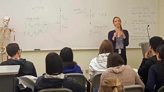 Alyssa Taylor teaches a class pre-COVID-19