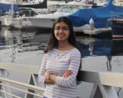 Ankita Joshi standing on a pier