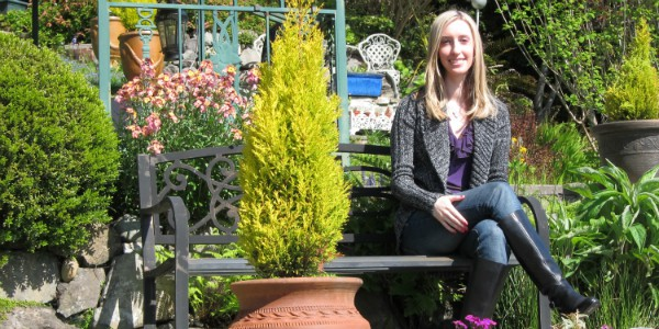 Dr. Alyssa Taylor sitting on a bench in a garden