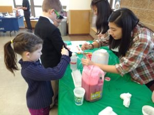 Student and child at iGEM outreach event