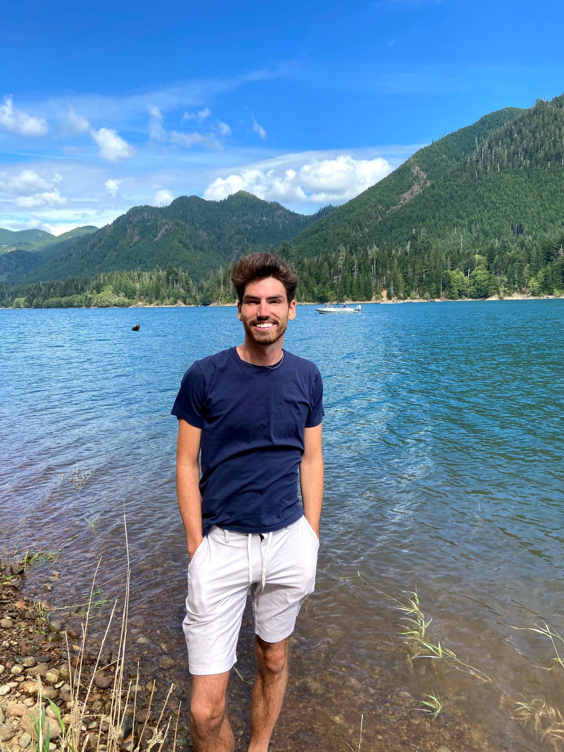 Jamison Siebart in front of lake and mountains, wide shot