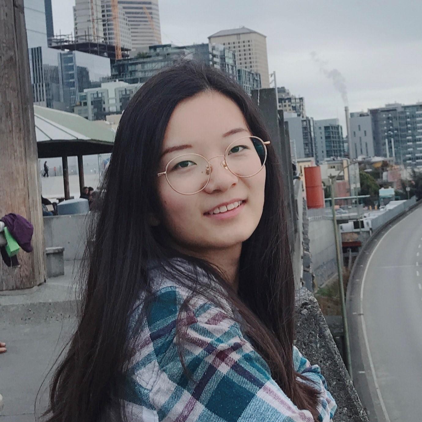 medium shot of Laura Lyu with city background