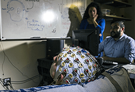 Researchers studying neural activity